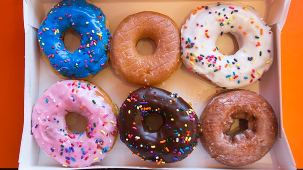 Sept. 2, 2014: A box of donuts, (from top L clockwise) manager's special, traditional glazed, vanilla, pumpkin, chocolate and strawberry, is pictured at a newly opened Dunkin' Donuts store in Santa Monica, California.