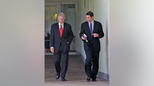 President Bill Clinton, left, walks with Doug Band.