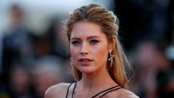 """May 20, 2015. Model Doutzen Kroes poses on the red carpet as she arrives for the screening of the film """"Youth"""" in competition at the 68th Cannes Film Festival in Cannes, southern France."""