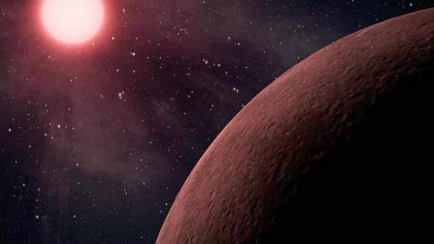 """This artist's rendering shows a dwarf star and its planets. Some planets around these kinds of stars might seem habitable, but they're really """"mirage planets."""""""