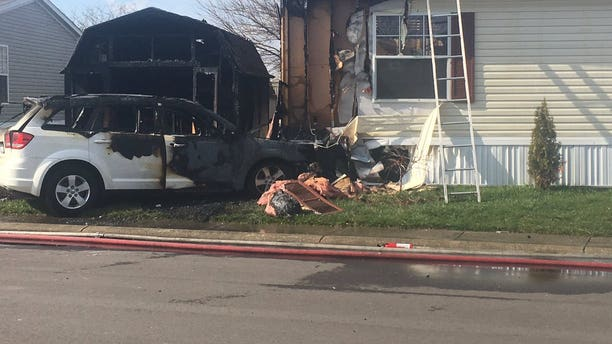 Officials say a girl learning how to drive accidentally hit the gas pedal instead of the brake after missing a turn, hitting a mobile home in Indianapolis Monday. (Fox 59)