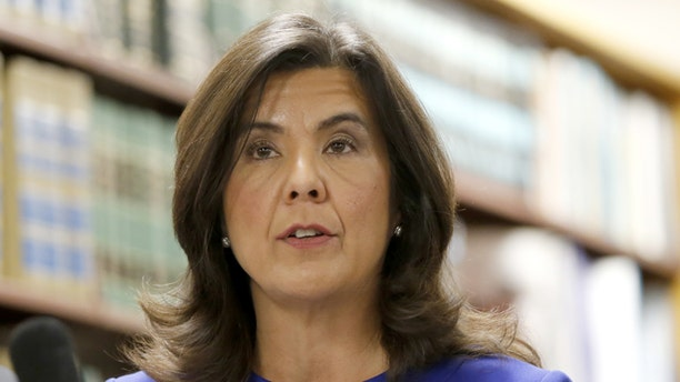 Cook County State's Attorney Anita Alvarez talks to reporters after the bond hearing for Chicago police officer Jason Van Dyke, on murder charges in the killing of 17-year-old Laquan McDonald, Tuesday, Nov. 24, 2015, in Chicago. Van Dyke's hearing is just a day ahead of a deadline for the city to release a squad-car video of the shooting. (AP Photo/Charles Rex Arbogast)