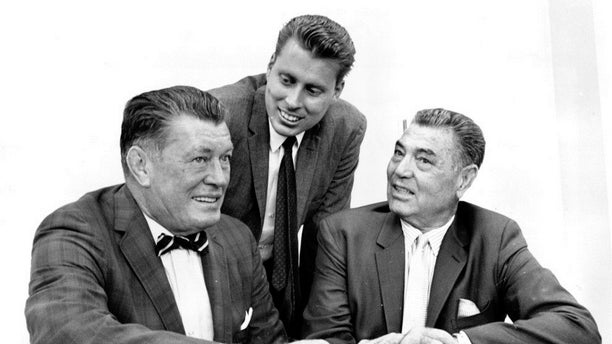 Boxing legends Gene Tunney, left, and Jack Dempsey, right, pose with Tunney's son, John V. Tunney, at a news conference in Los Angeles. Sept. 23, 1964.