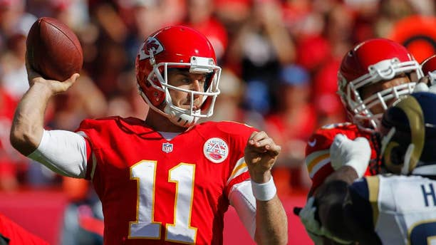 Kansas City Chiefs quarterback Alex Smith (11) throws in the first half of an NFL football game against the St. Louis Rams in Kansas City, Mo., Sunday, Oct. 26, 2014. (AP Photo/Colin E. Braley)