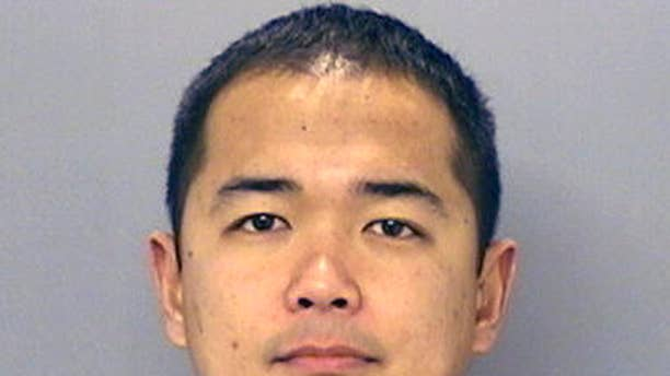 This undated photo provided by the San Diego Police Department shows San Diego Police officer Jonathan DeGuzman who was killed in a shooting  Thursday, July 28, 2016. DeGuzman, a 16-year veteran, is survived by a wife and two young children. A suspect was wounded and taken into custody a short time later and hours later police surrounded a home as they searched for man described as a possible accomplice. (San Diego Police Department via AP)