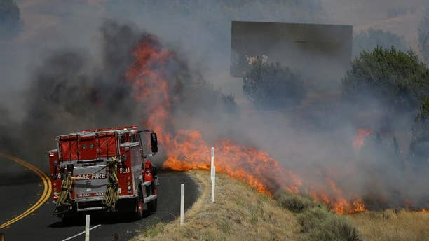 Flames approaching a fire truck near Lake Isabella, Calif. on Friday.