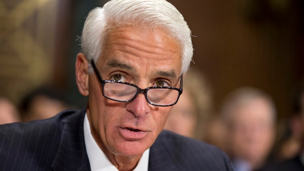FILE - In this Dec. 19, 2012 file photo, former Florida Gov. Charlie Crist delivers a statement before the Senate Judiciary Committee on Capitol Hill in Washington. Crist, a former Republican governor, filed paper work Friday, Nov. 1, 2013, to run for governor as a Democrat. (AP Photo/J. Scott Applewhite, File)