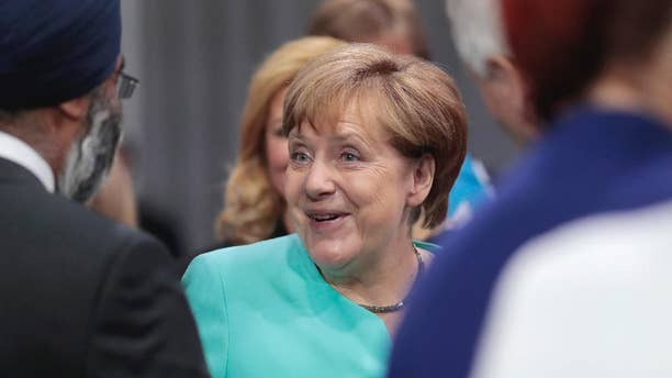German Chancellor Angela Merkel smiles before the first working session of the North Atlantic Council at the NATO summit in Warsaw, Poland, Friday, July 8, 2016. Starting Friday, US President Barack Obama and leaders of the 27 other NATO countries will take decisions in Warsaw on how to deal with a resurgent Russia, violent extremist organizations like Islamic State, attacks in cyberspace and other menaces to allies' security during a summit described by many observers as NATO's most crucial meeting since the 1989 fall of the Berlin Wall.(AP Photo/Markus Schreiber)