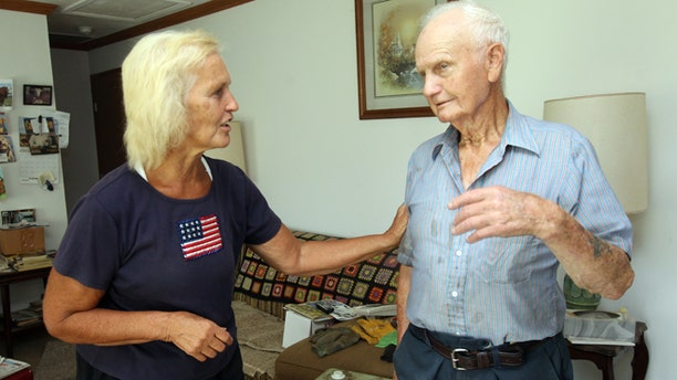 """Sept. 3, 2012: Mary Simpson, left, a neighbor of Earl Jones, 92, who shot and killed a burglar in his home on Sept 3, 2012, talks with Jones in his living room. """"I came over here to commend him,"""" said Simpson, """"he's terrific."""""""
