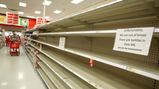Shoppers encounter empty bread shelves ahead of the arrival of Hurricane Irma at a supermarket in Kissimmee, Florida, U.S. September 8, 2017. REUTERS/Gregg Newton - RC1A9B5359F0