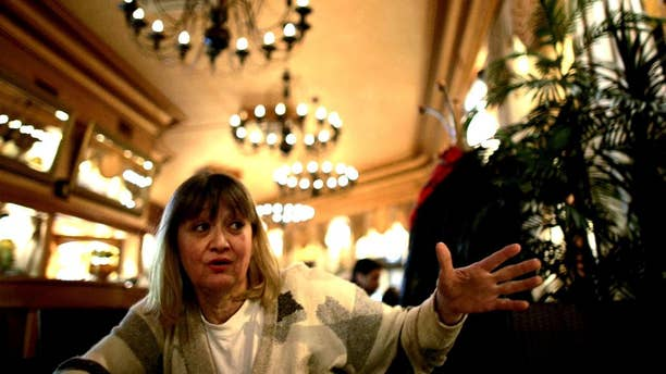 FILE-In this Friday, Feb. 15, 2008 file photo, Vesna Vulovic, an ex-air stewardess, and survivor of a fall from 10,000 meters when in 1972 her plane was blown up in mid-fight by a bomb, gestures as she gives an interview to the Associated Press in Belgrade, Serbia.   Serbia's state TV reports Saturday Dec. 24, 2016, Vulovic was found dead by her friends in her apartment in Belgrade, aged 66. (AP Photo/Marko Drobnjakovic)