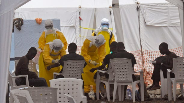 Health workers, attend to patients that contracted the Ebola virus, at a clinic  in Monrovia, Liberia, Monday, Sept. 8, 2014. (AP Photo/Abbas Dulleh)