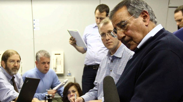 Oct. 2: U.S. Secretary of Defense Leon Panetta answers questions aboard an Air Force plane over the Atlantic Ocean.