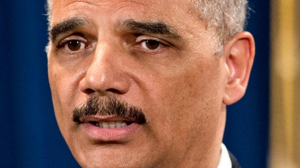 """Attorney General Eric Holder is questioned about the Justice Department secretly obtaining two months of telephone records of reporters and editors for The Associated Press, during a news conference at the Justice Department in Washington, Tuesday, May 14, 2013. In what the news cooperative's top executive called a """"massive and unprecedented intrusion,"""" the Justice Department monitored outgoing calls for the work and personal phone numbers of individual reporters, for general AP office numbers in New York, Washington and Hartford, Conn., and for the main number for the AP in the House of Representatives press gallery, according to attorneys for the AP.  (AP Photo/J. Scott Applewhite)"""