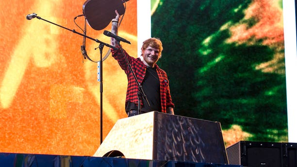 Singer Ed Sheeran performs at the Glastonbury Festival at Worthy Farm, in Somerset, England, Sunday, June 25, 2017. (Photo by Grant Pollard/Invision/AP)