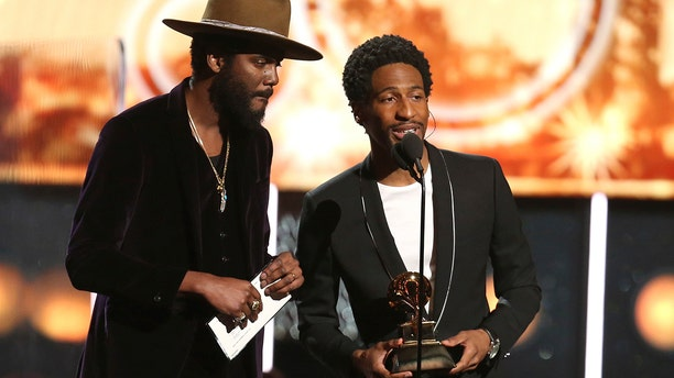 Gary Clark Jr. , left, and Jon Batiste announce that the award for best pop solo performance is won by Ed Sheeran at the 60th annual Grammy Awards at Madison Square Garden on Sunday, Jan. 28, 2018, in New York.