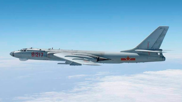 FILE: A Chinese military plane H-6 bomber flies through airspace in southern Japan