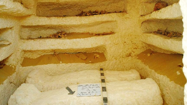 This undated photo released by the Egyptian Ministry of Antiquities shows sarcophagi in a Ptolemaic tomb in an area known as al-Kamin al-Sahraw, in the Nile Valley province of Minya south of Cairo. Egypt's antiquities ministry says that archaeologists have discovered three tombs dating back more than 2,000 years, from the Ptolemaic Period. (Egyptian Ministry of Antiquities via AP)