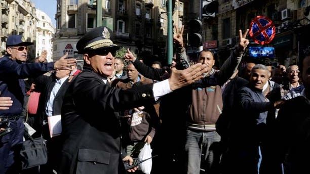 Jan. 29, 2015: Egyptian police try to clear the street where women rally at the spot where Shaimaa el-Sabbagh, a 32-year-old mother, was shot in downtown Cairo on Saturday near Talaat Harb Square, during a protest in Cairo, Egypt. (AP)