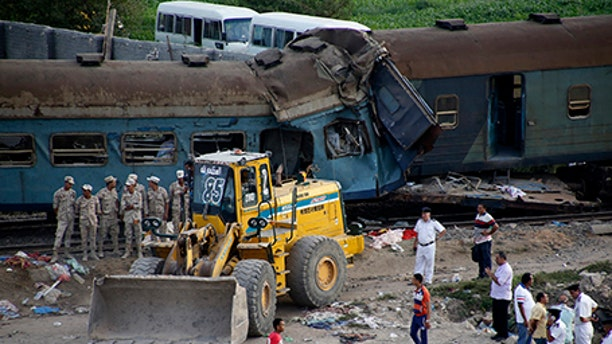 Two trains are seen after they collided just outside Egypt's Mediterranean port city of Alexandria, Friday.