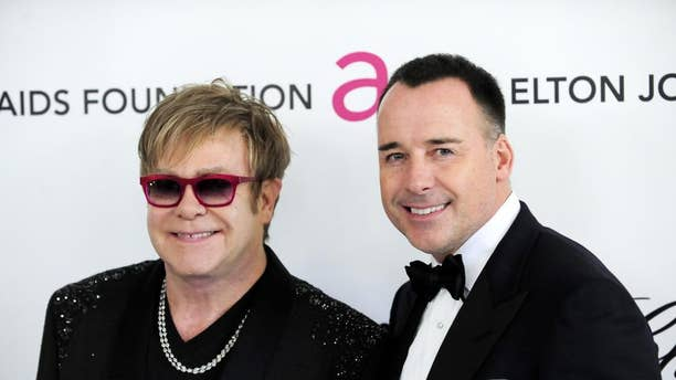 After an adoption effort fell through, Elton John and David Furnish turned to a gestational carrier in 2010 to give birth to their son Zachary.