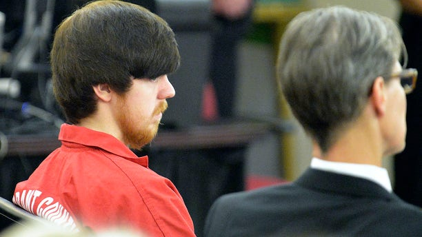 Ethan Couch seated next to his attorney, Scott Brown, as he appeared in his first adult court hearing in Fort Worth, Texas April 13, 2016.