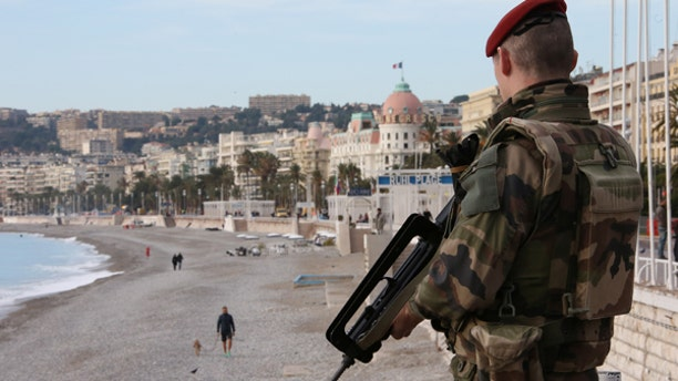 """A French soldier stands guard on the Promenade Des Anglais as part of the """"Vigipirate"""" security plan in Nice, France, December 12, 2016."""