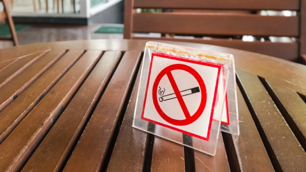 no smoking sign displayed in the public coffe shop
