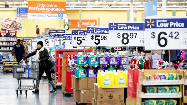 A customer pushes a shopping cart at a Walmart store in Chicago, Illinois, U.S. November 23, 2016. REUTERS/Kamil Krzaczynski - RTST0IQ
