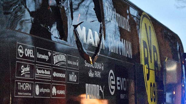 FILE - In this April 11, 2017 file photo a  window of Dortmund's team bus is damaged after an explosion before the Champions League quarterfinal soccer match between Borussia Dortmund and AS Monaco in Dortmund,  Germany. German prosecutors say they're staging a reconstruction of last week's attack on Borussia Dortmund's team bus as they look for clues on the perpetrators. (AP Photo/Martin Meissner,file)
