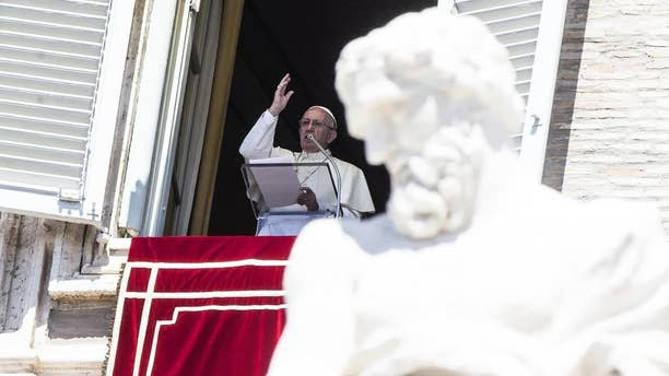 "Pope Francis waves to faithful from the window of his studio overlooking St. Peter's Square, at the Vatican Monday, Aug. 15, 2016.  Pope Francis is urging people to think about the plight of women who are ""slaves of the arrogance of the powerful"" as well as children forced to do ""inhumane"" work. In remarks to tourists and pilgrims in St. Peter's Square Monday, Francis decried that some women ""are obliged to surrender in body and spirit to the covetousness of men."" (Angelo Carconi/ANSA via AP)"