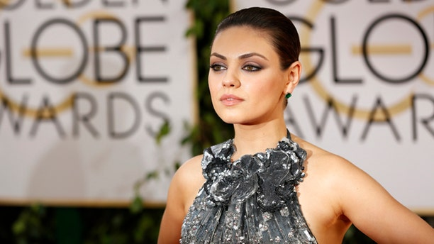 January 12, 2014. Actress Mila Kunis arrives at the 71st annual Golden Globe Awards in Beverly Hills, California.