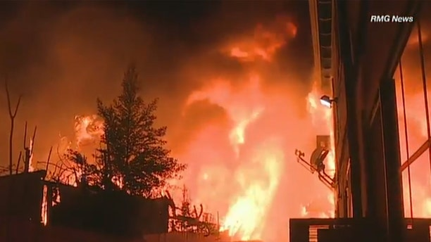 Residents helped evacuated an apartment building in North Hollywood, Calif. early Wednesday after a raging fire broke out.