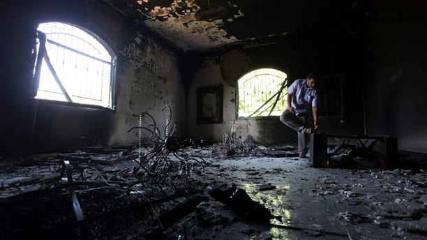 Sept. 13, 2012: A Libyan man investigates the inside of the U.S. Consulate after the attack that killed four Americans.