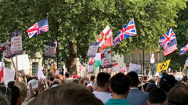 Flags and banners over the march.