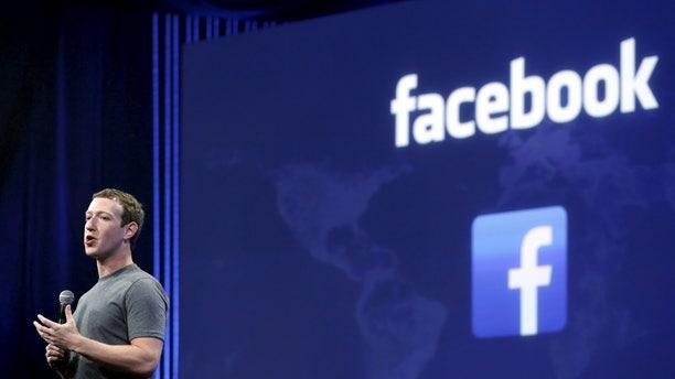File photo - Facebook CEO Mark Zuckerberg speaks during his keynote address at Facebook F8 in San Francisco, Calif. March 25, 2015. (REUTERS/Robert Galbraith)