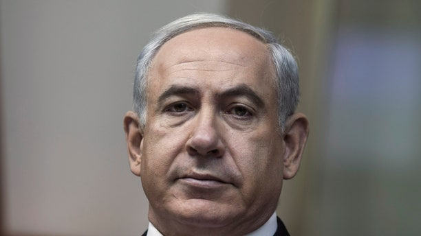 Israeli Prime Minister Benjamin Netanyahu chairs the weekly cabinet meeting in his Jerusalem offices, Sunday, Feb. 3, 2013. Israel's president formally asked Prime Minister Benjamin Netanyahu on Saturday Feb. 2, 2013 to form the next government, and Netanyahu pledged that his new administration will be committed to advancing peace talks with the Palestinians.(AP Photo/Oliver Weiken, Pool)
