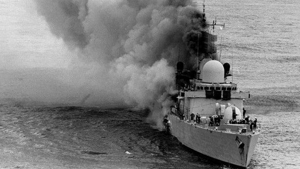 Apr. 20, 1982: British Royal Navy HMS Sheffield frigate, damaged from Argentine Exocet missile, before sinking, during The Falkland Islands war. (AP)
