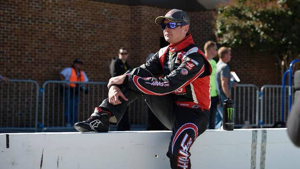 Kurt Busch looks on before qualifying for a NASCAR Sprint Cup series auto race, Friday, Sept. 26, 2014, at Dover International Speedway in Dover, Del. (AP Photo/Nick Wass)