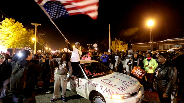 Oct. 11, 2014: Protesters arrive at the Ferguson Police Department for a rally in remembrance of Michael Brown in Ferguson, Mo.
