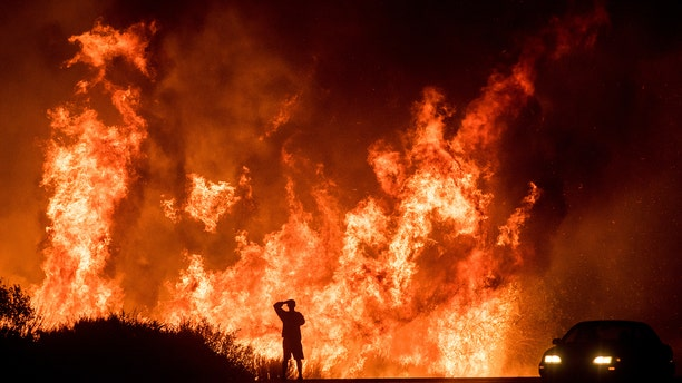 Wildfires continued to spread Friday across Southern California, with local officials confirming the first fatality.