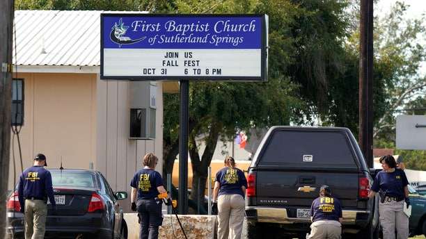 Members of the FBI Evidence Response Team use metal detectors outside the site of the shooting at the First Baptist Church of Sutherland, Texas, U.S., November 6, 2017. REUTERS/Rick Wilking - RC15DC1B1320
