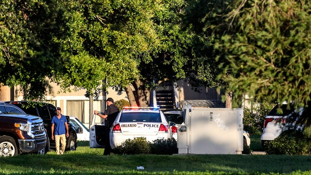 Police continue to work at the scene of a hostage standoff where a police officer was shot.