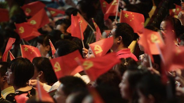 People wave flags of China's Communist Party at a celebration of the Communist Party's 90th anniversary in Chongqing  municipality July 1.