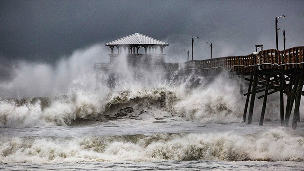 Waves slam the Oceana Pier & Pier House Restaurant in Atlantic Beach, North Carolina on Thursday as Hurricane Florence approached the area.