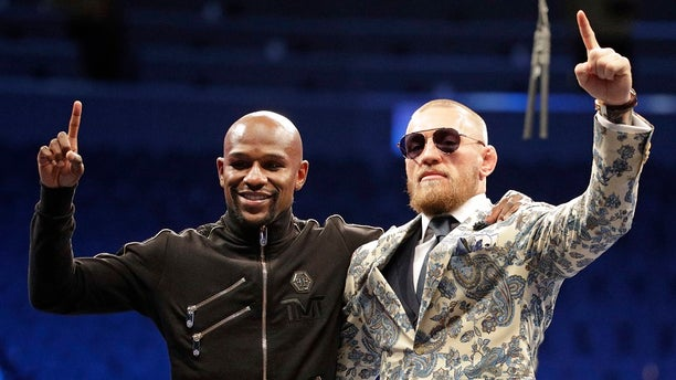 """The boxer and UFC fighter left """"The Biggest Fight in Combat Sports History"""" with some serious prize money."""