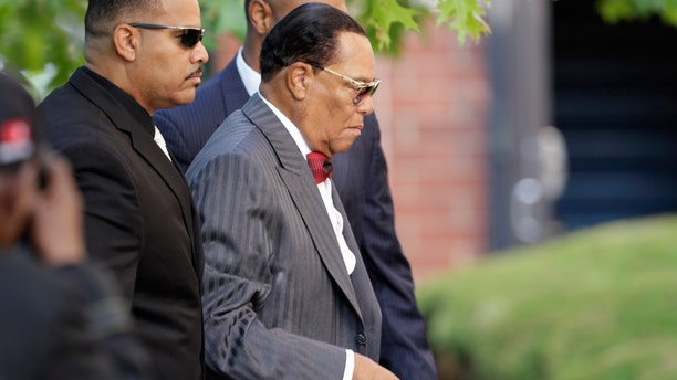 Religious leader Louis Farrakhan, right, arrives at Greater Grace Temple for legendary singer Aretha Franklin's funeral in Detroit, Friday, Aug. 31, 2018. Franklin died Aug. 16 of pancreatic cancer at the age of 76.