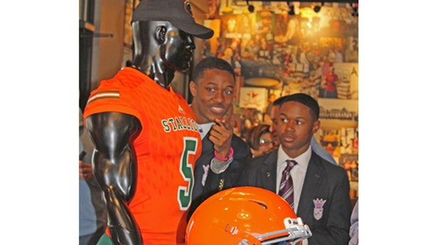 Two students participated in the unveiling of Frederick Douglass High School's Stallions colors and gear Monday.