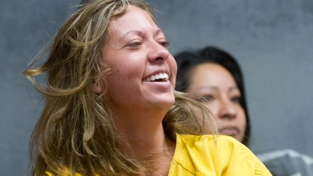 Aug. 11: Lee Grace Dougherty, 29, laughs at the Pueblo County Sherrif's Office detention center.