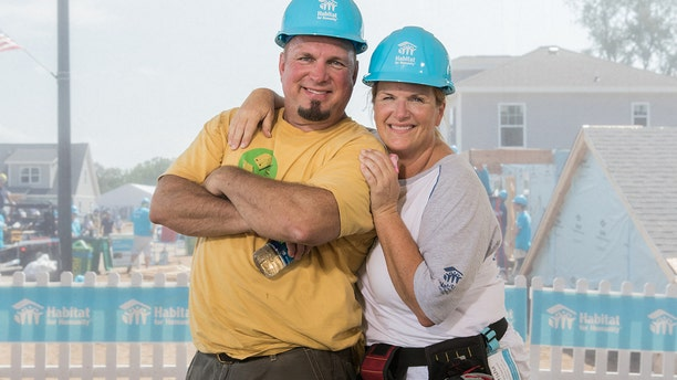 Garth Brooks and Trisha Yearwood help to build a home in South Bend, Indiana through Habitat for Humanity.